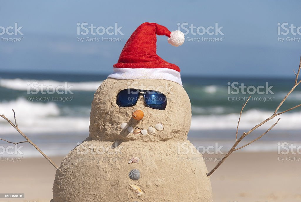 Snowman Made Out Of Sand With Santa Hat royalty-free stock photo
