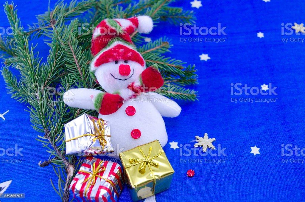 Snowman on a blue Christmas table cloth royalty-free stock photo