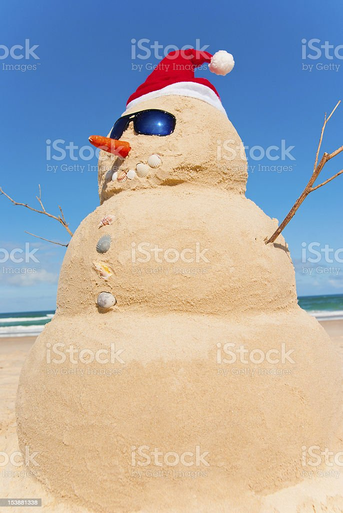 Snowman on Australian beach during Christmas royalty-free stock photo