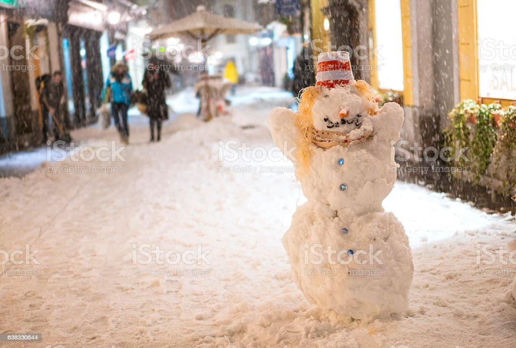 Snowman on street in old Ljubljana, Slovenia stock photo