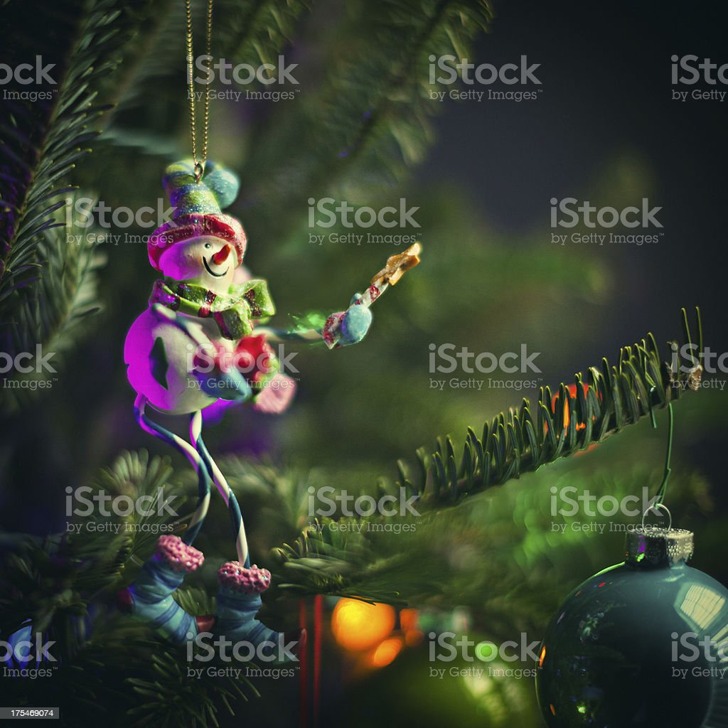 snowman ornament on a tree royalty-free stock photo