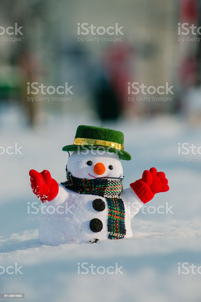 Snowman stand among pile of snow. stock photo