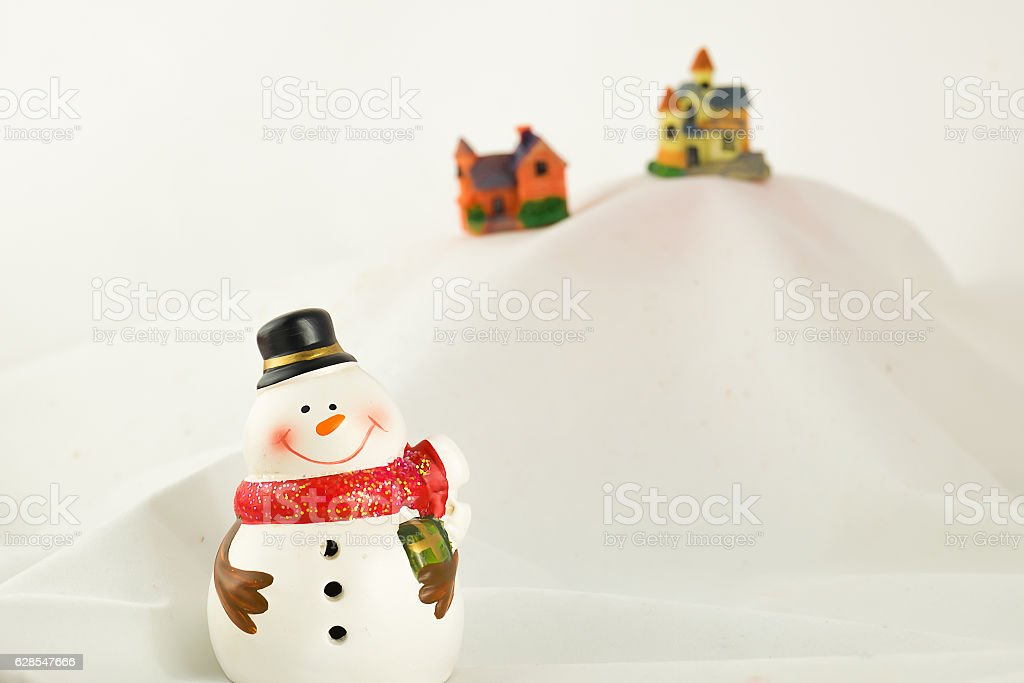 Snowman stand on iceberg background, Christmas concept stock photo