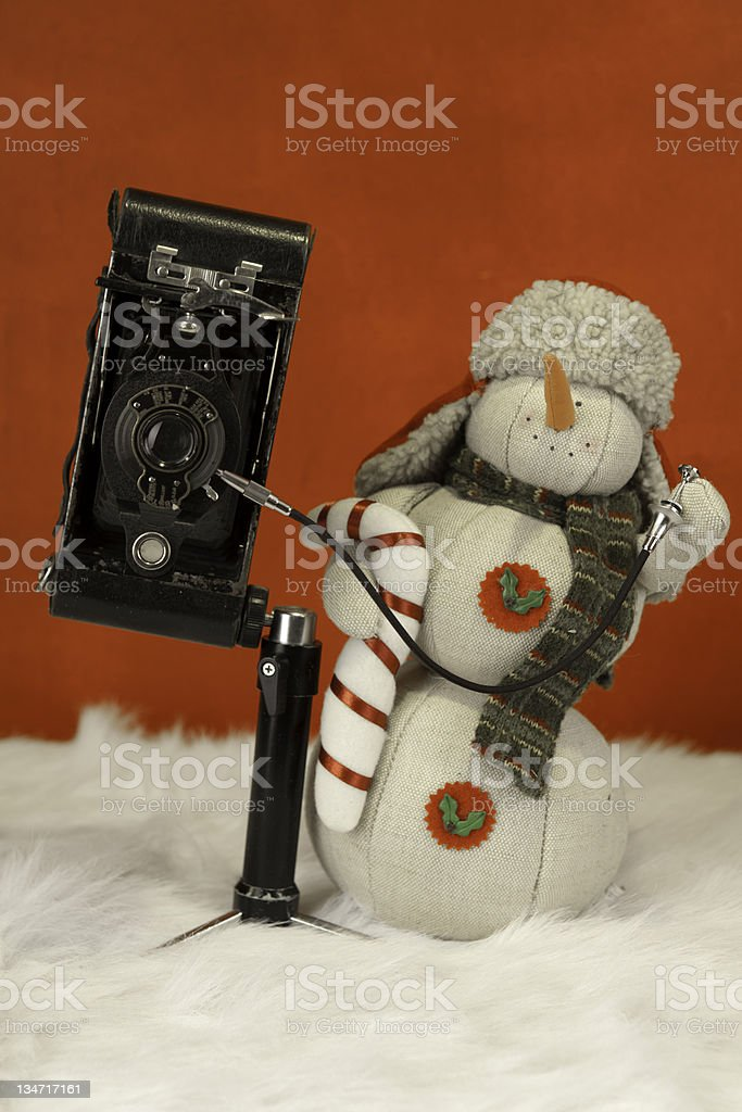 Snowman taking pictures royalty-free stock photo