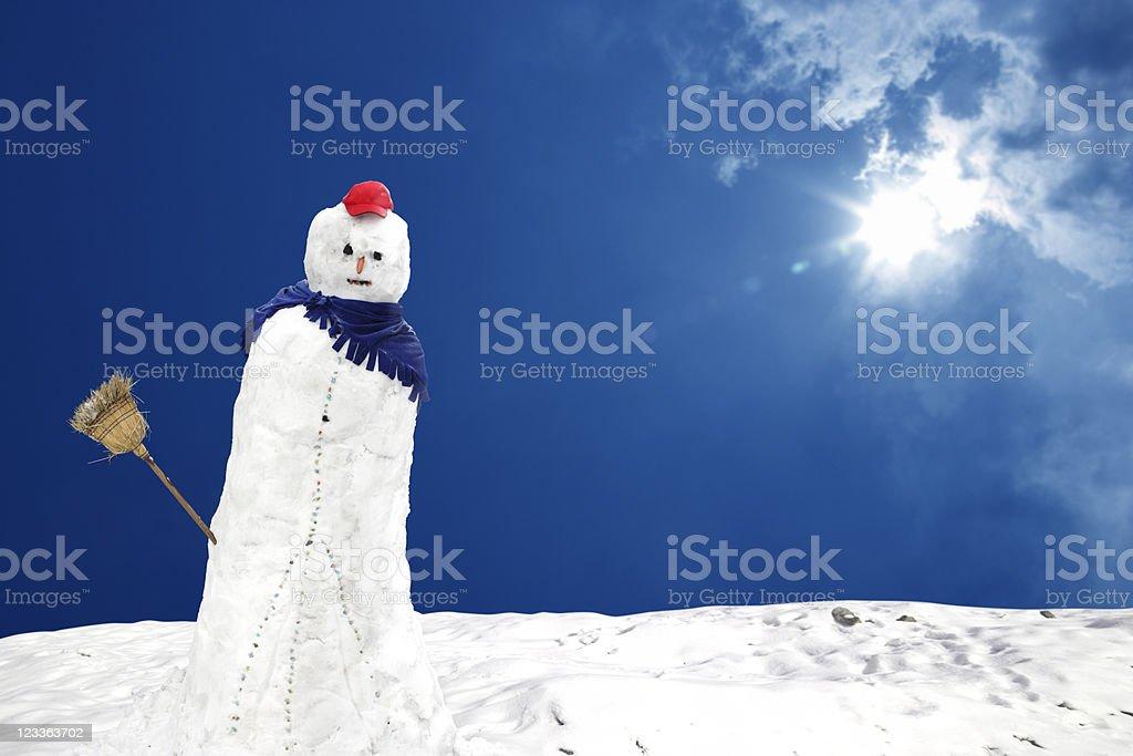 snowman under sun stock photo