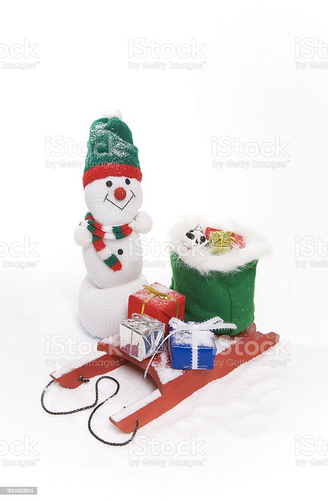Snowman with a Sled of Gifts stock photo
