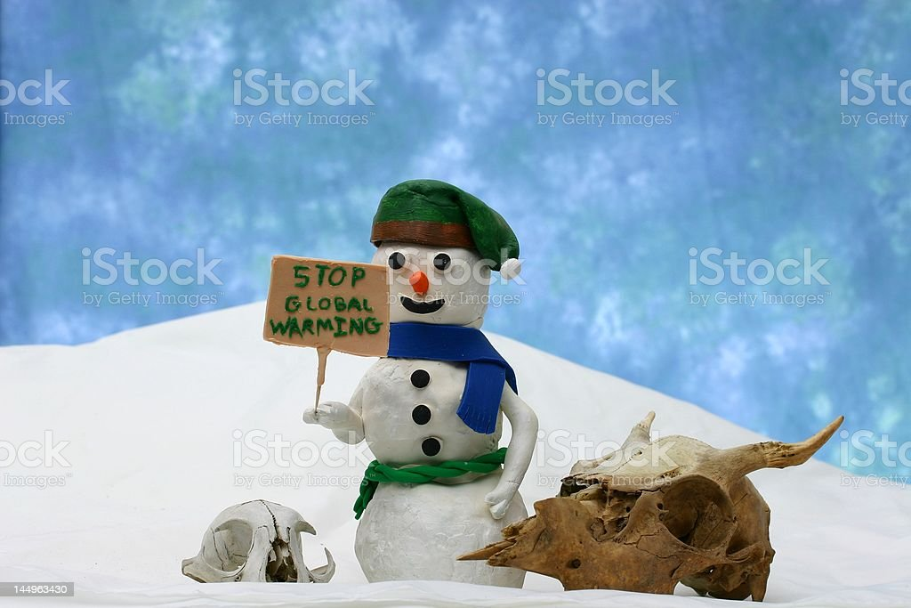 Snowman with a 'stop global warming' sign royalty-free stock photo