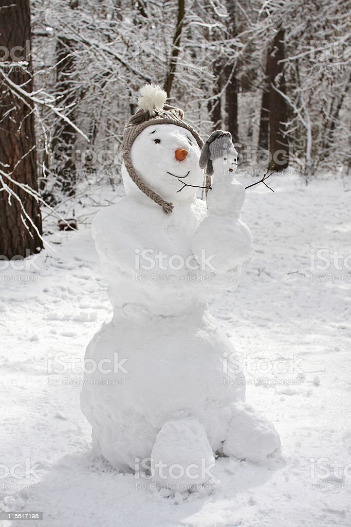 Snowman with baby royalty-free stock photo