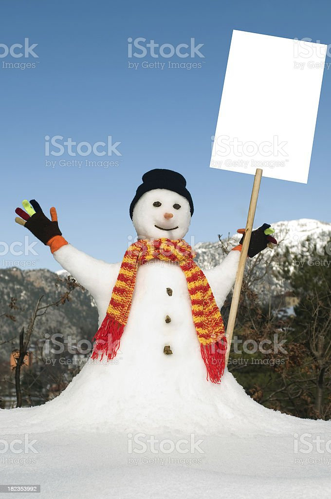 Snowman with blank sign royalty-free stock photo