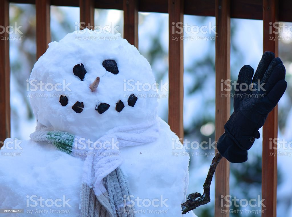 Snowman with gloves and scarf stock photo