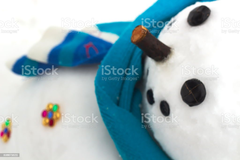 Snowman with golden buttons stock photo