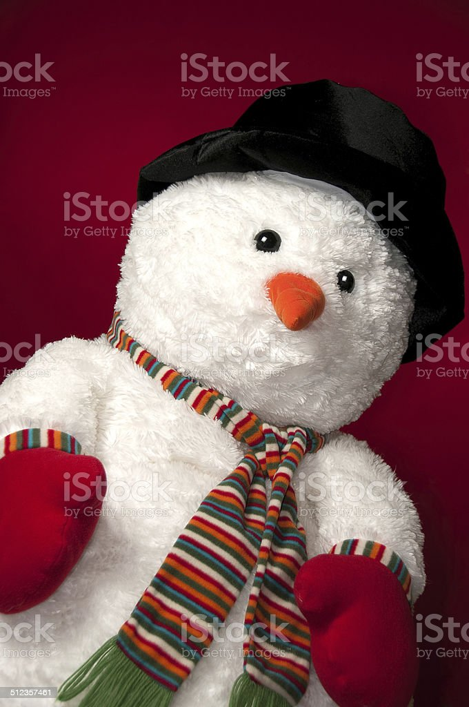 Snowman with red background - vertical stock photo