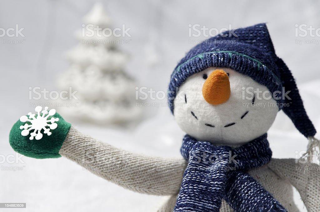 Snowman with snowflake. royalty-free stock photo