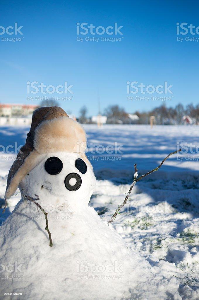 Pupazzo di neve con cappello invernale foto stock royalty-free