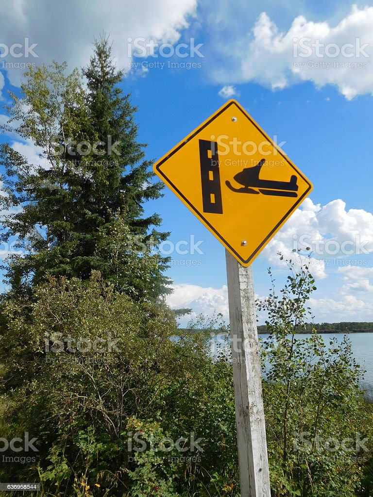 Snowmobile Crossing Sign During the Summer stock photo