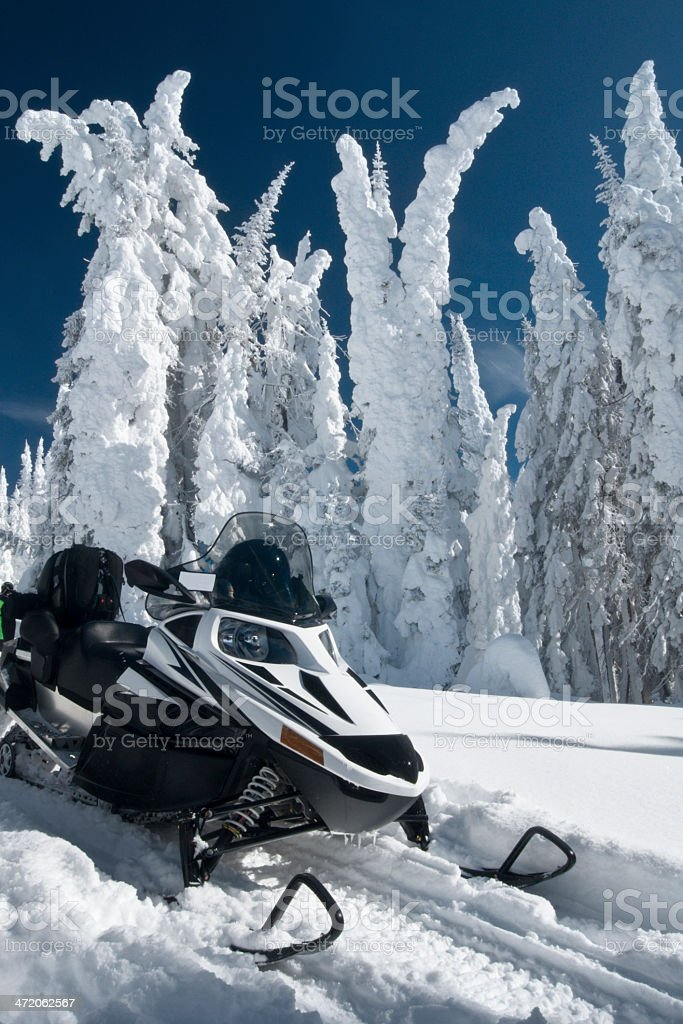Snowmobile in hoar-frosted forest stock photo