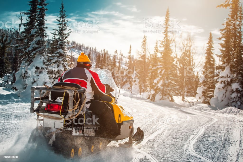 snowmobile in mountains stock photo