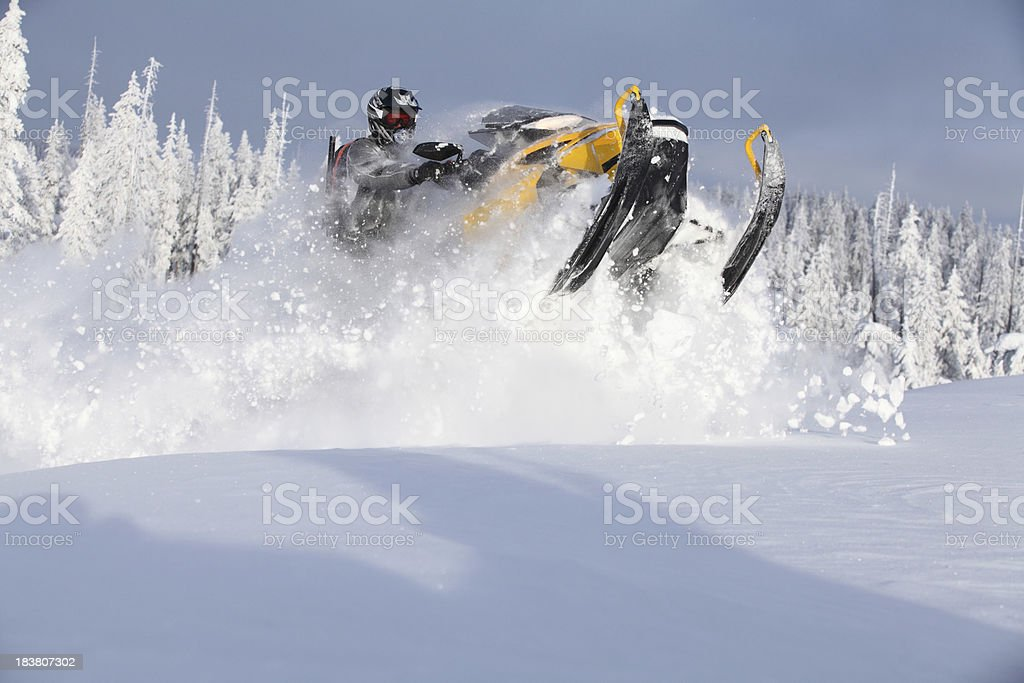 Snowmobile jumping royalty-free stock photo