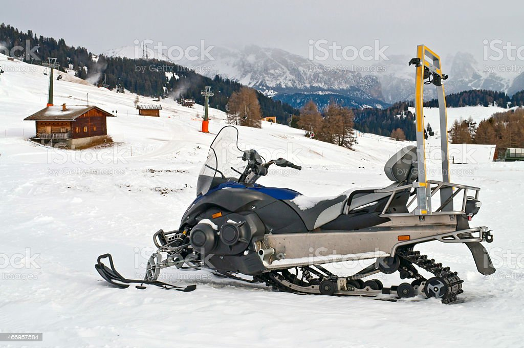 Snowmobile on alps in winter time stock photo