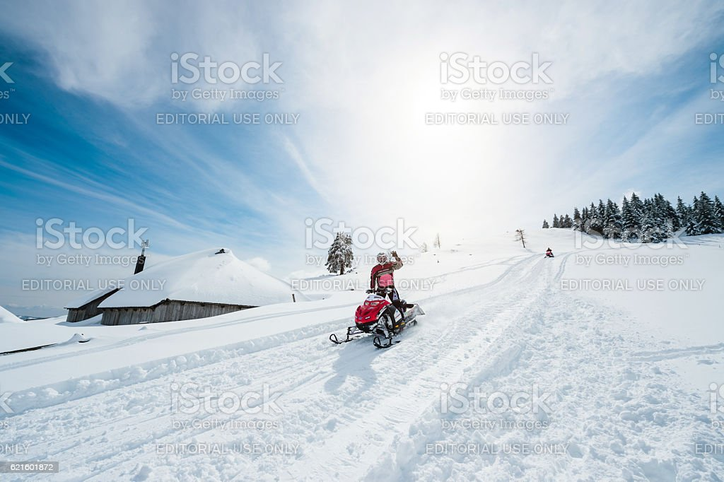 Snowmobile On Sunny Winter Day stock photo