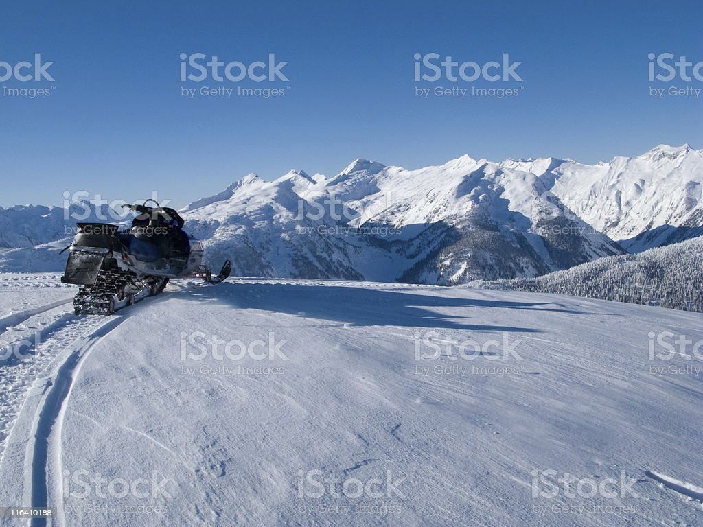 snowmobile on top of the world stock photo
