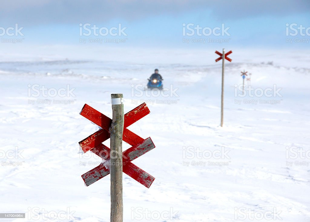 Snowmobile on track in winter scene royalty-free stock photo