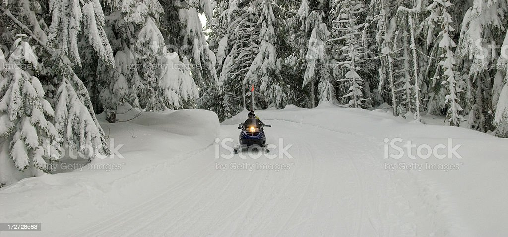 Snowmobile riders royalty-free stock photo