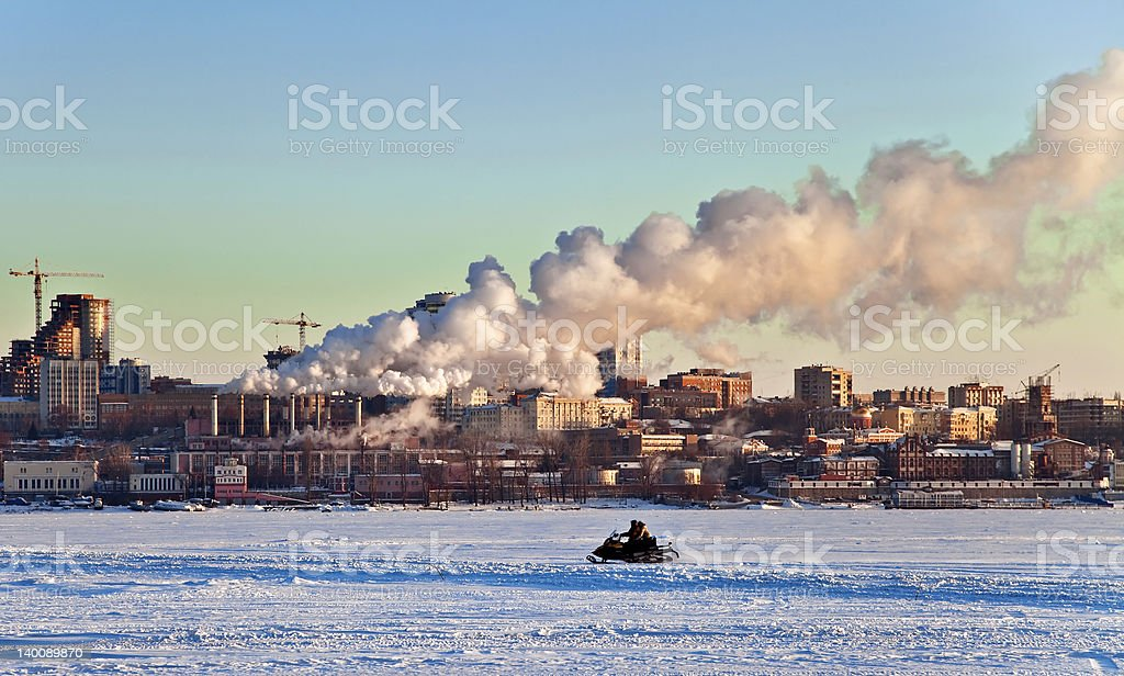 Snowmobile rides on the frozen river royalty-free stock photo
