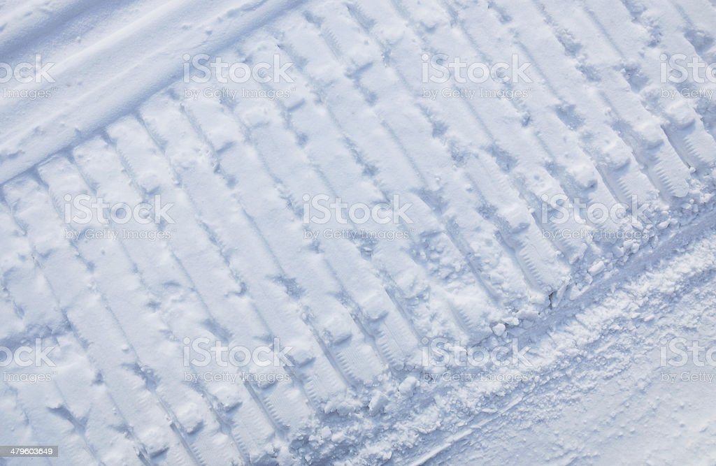 Snowmobile traces on snow stock photo