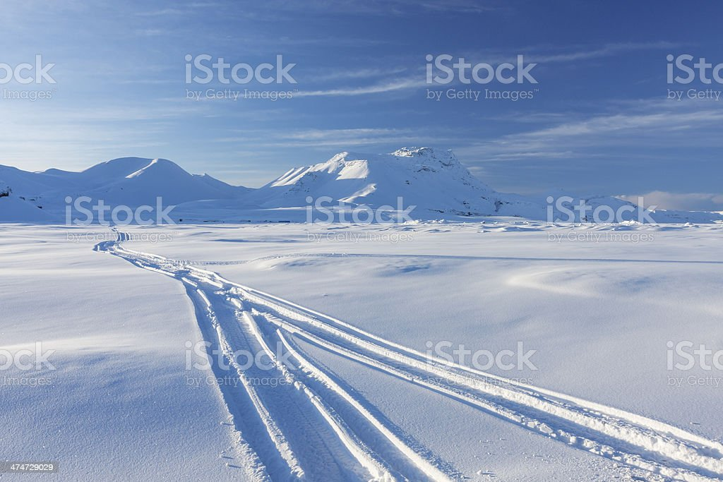Snowmobile traces stock photo