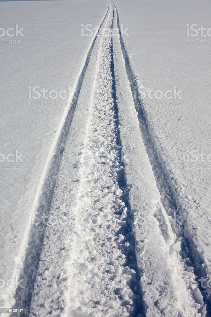 Snowmobile track in fresh clean snow royalty-free stock photo