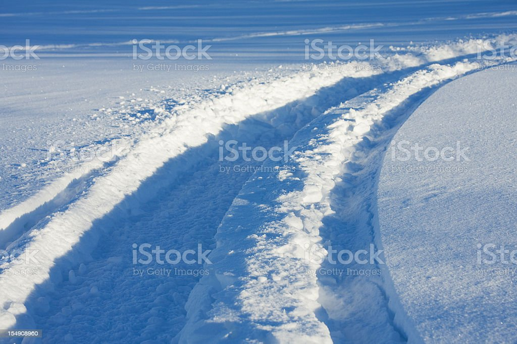 Snowmobile Tracks in Fresh Snow stock photo