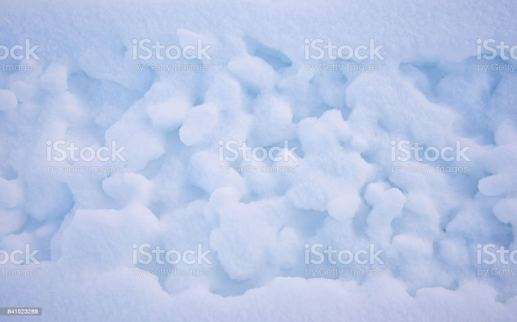 Snowmobile tracks in snow mountains as background. Winter season. The road is covered with snow after snowfall stock photo