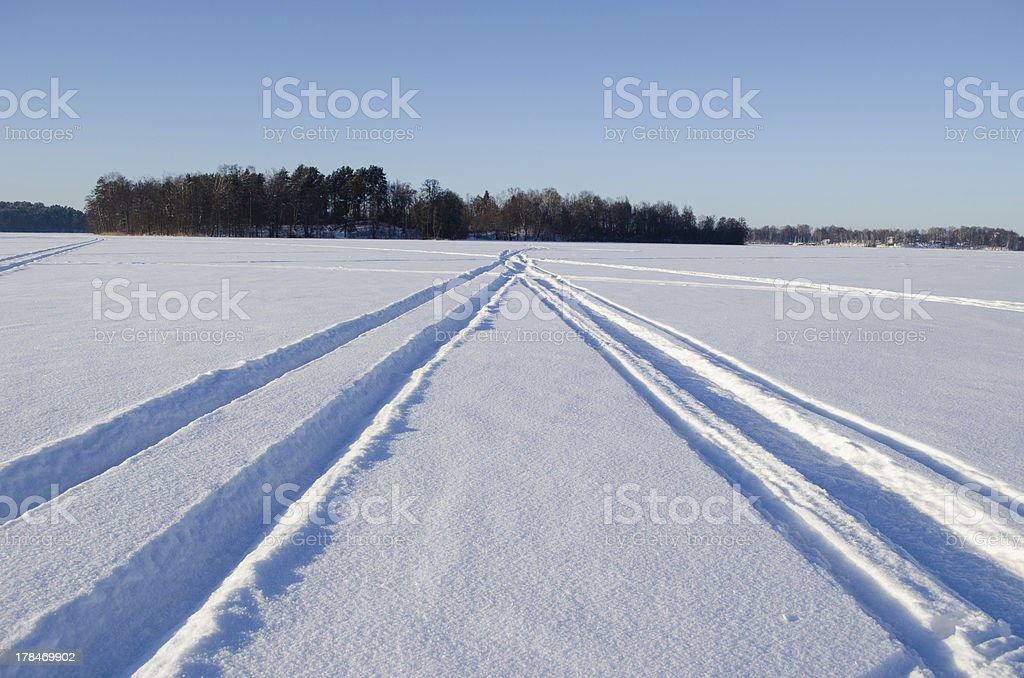 Snowmobile winter transport marks frozen lake snow stock photo