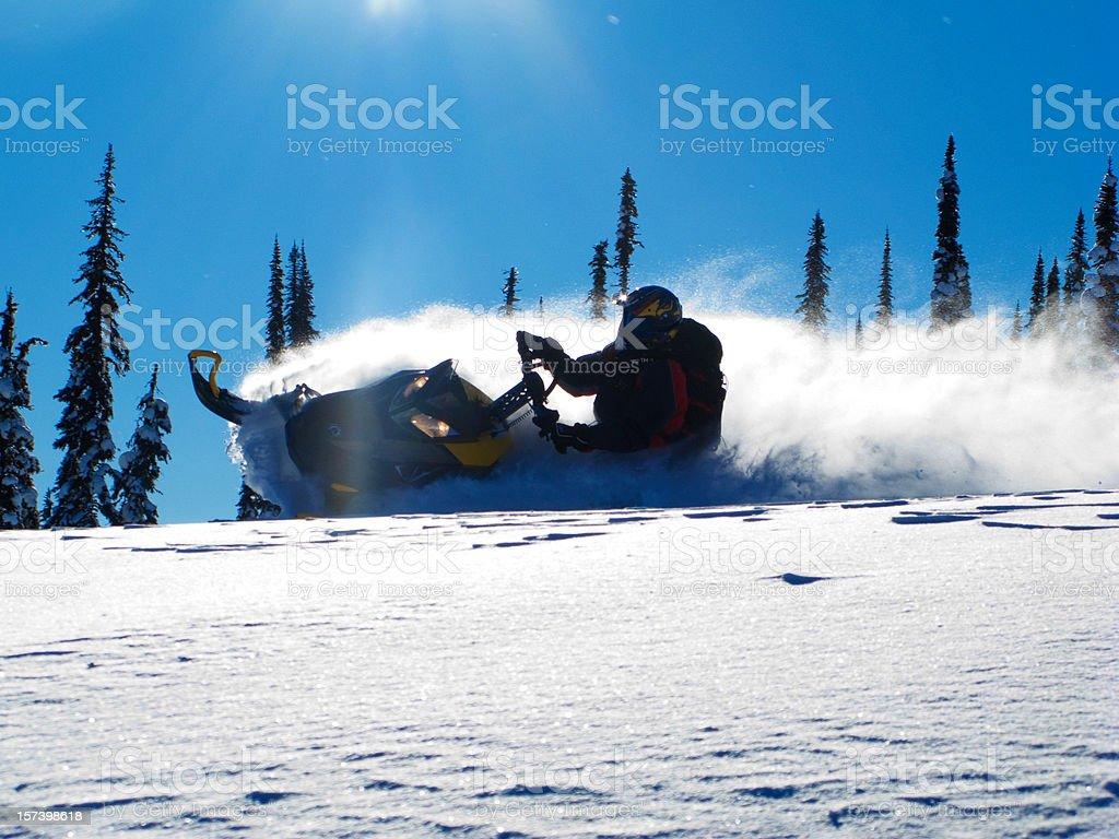 Snowmobiler in the fresh powder. royalty-free stock photo