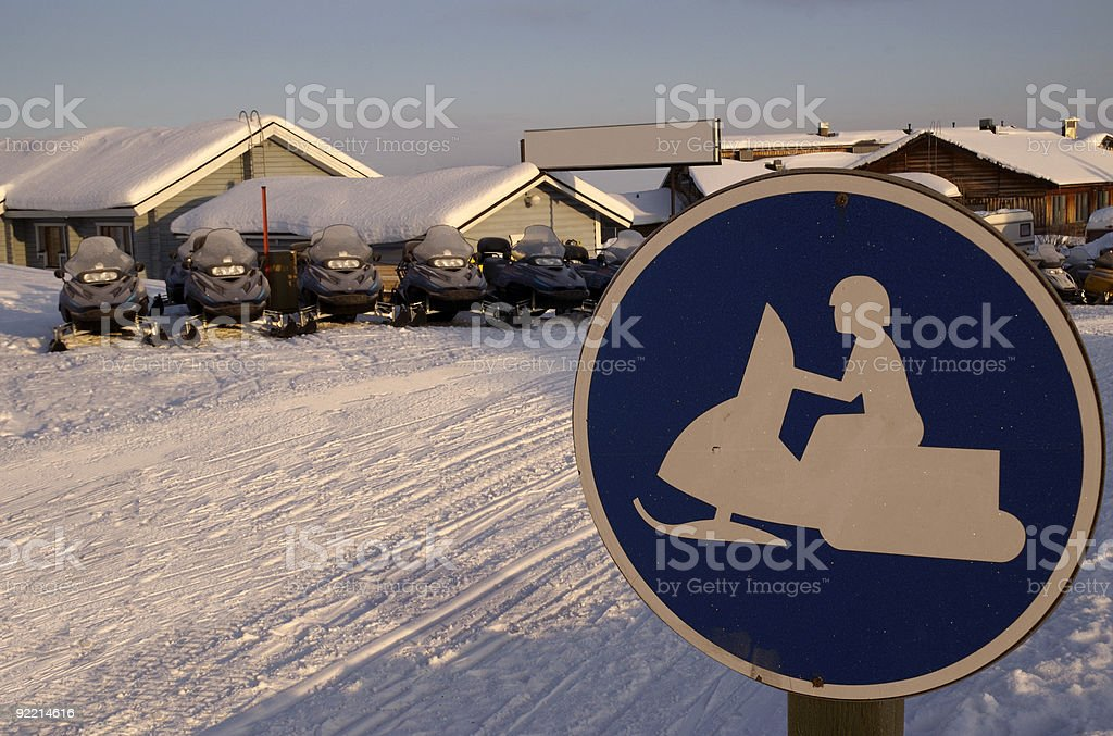 Snowmobiles and Snowmobile sign royalty-free stock photo