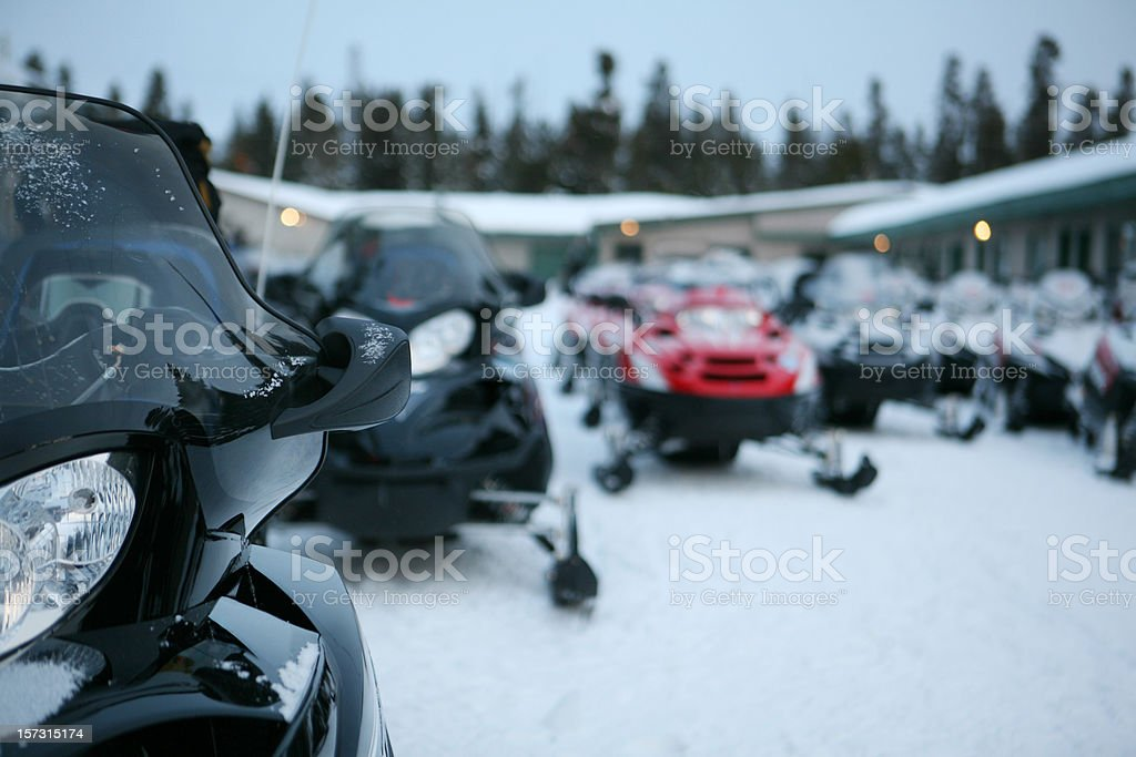 Snowmobiles in Early Morning Light stock photo