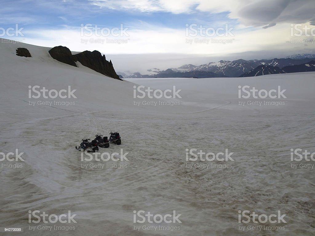 Snowmobiles on glacier stock photo