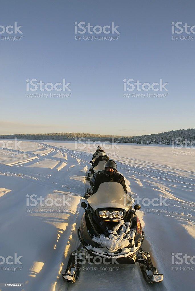 snowmobiles on tour winter finland - lapland royalty-free stock photo