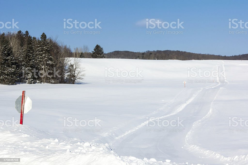 Snowmobiling trail in a winter landscape stock photo