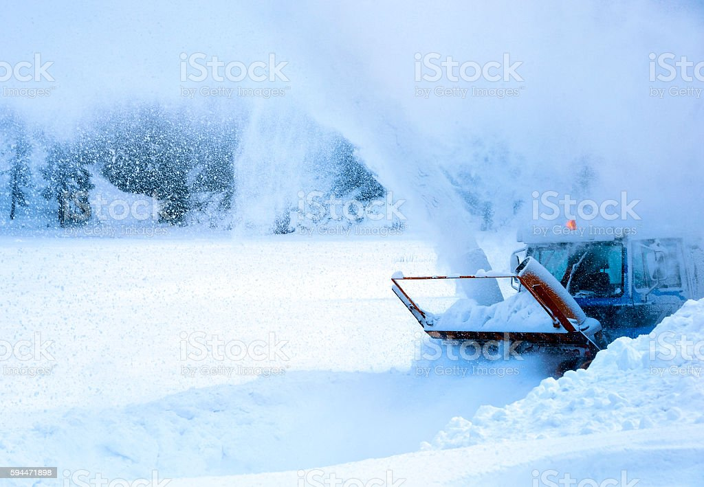 Snowplow in action stock photo