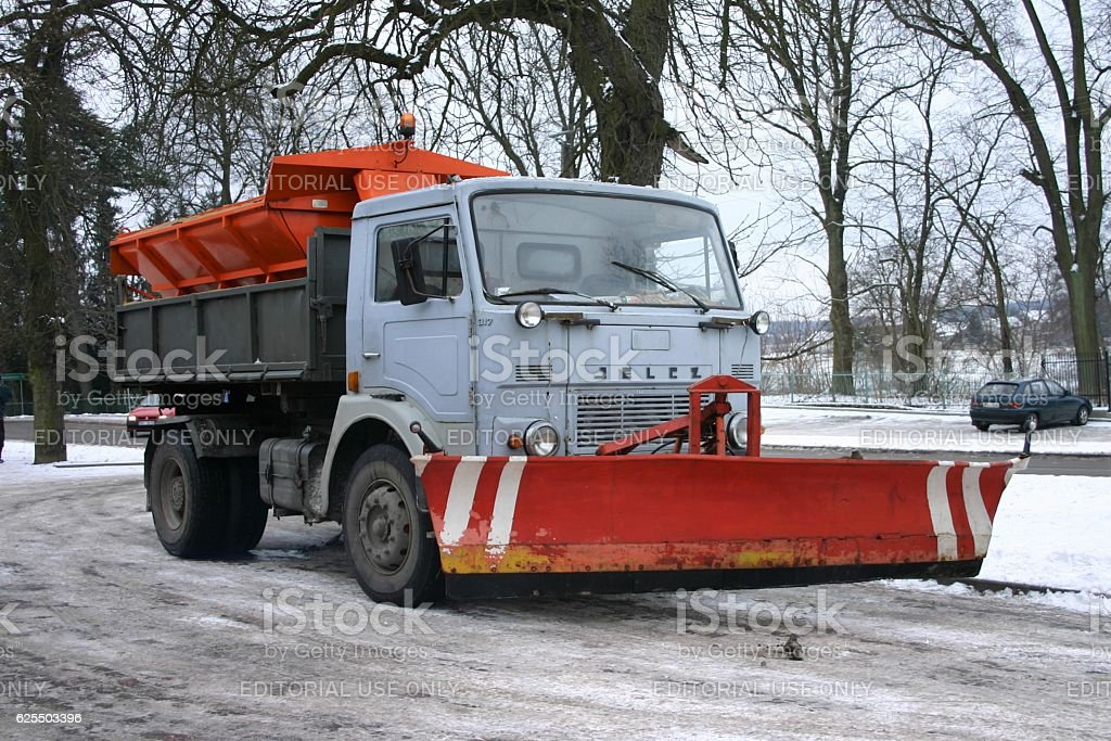 Snowplow Jelcz 317 truck on the street stock photo