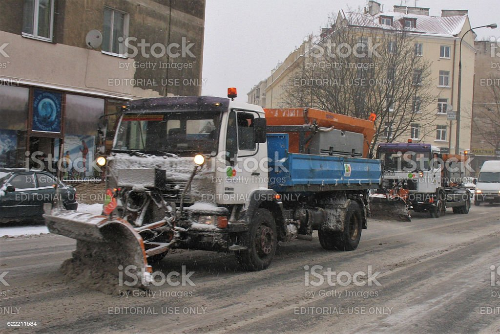Snowplow trucks on the street stock photo