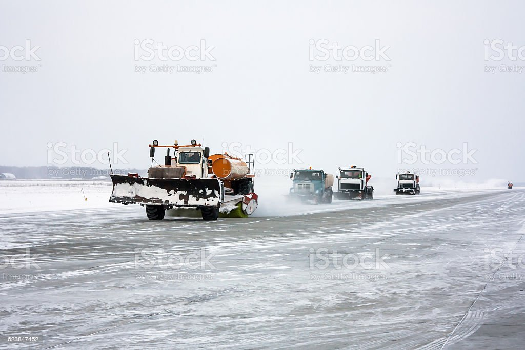 Snowplows cleans the runway royalty-free stock photo