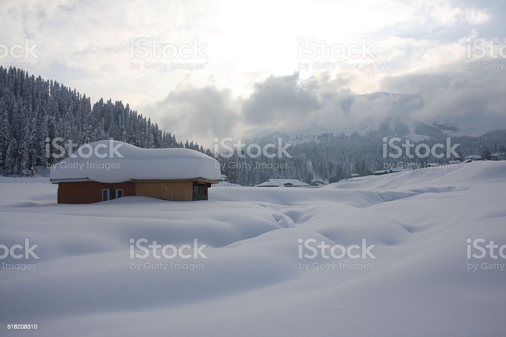 Snow-scape with Hut in Kashmir, India stock photo