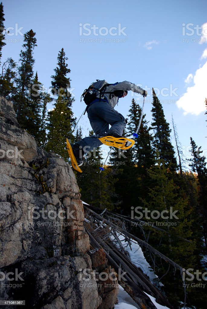 Snowshoeing -A Leap of Faith stock photo