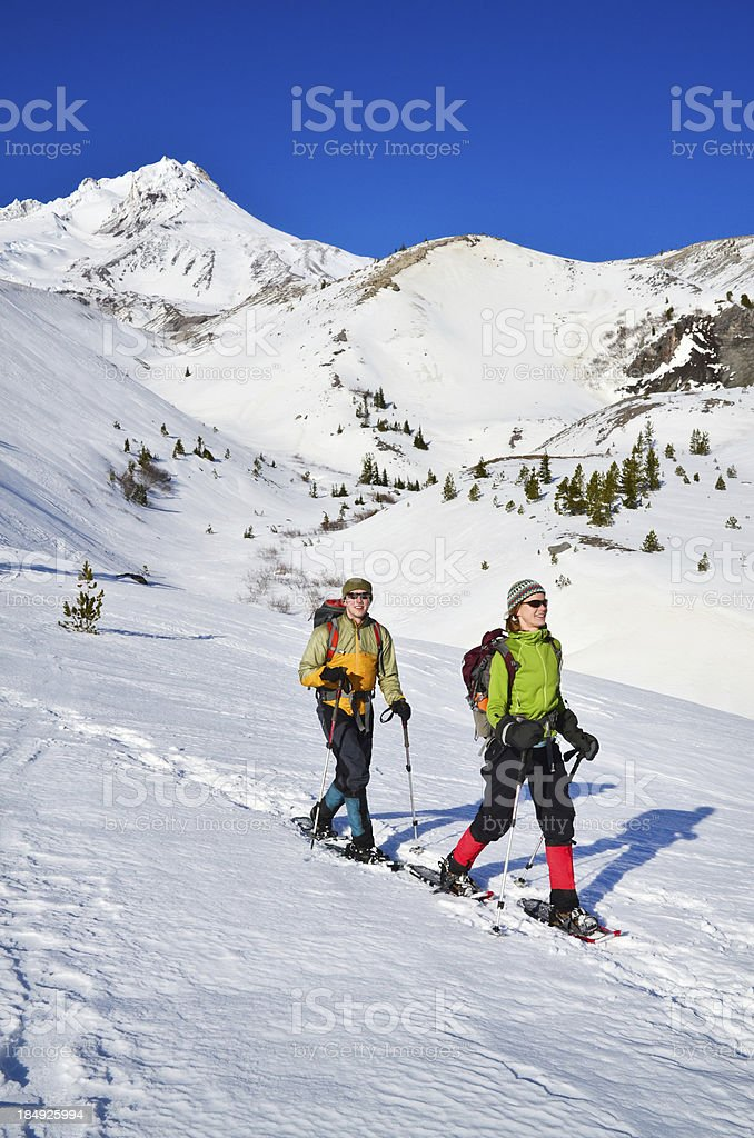 Snowshoeing Couple royalty-free stock photo