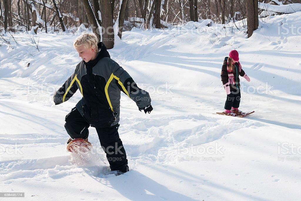 Snowshoeing cousins stock photo