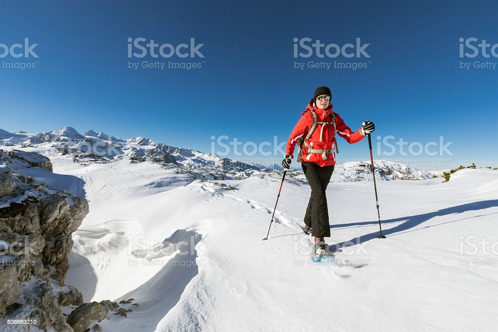 Snowshoeing in powder snow, Austria stock photo