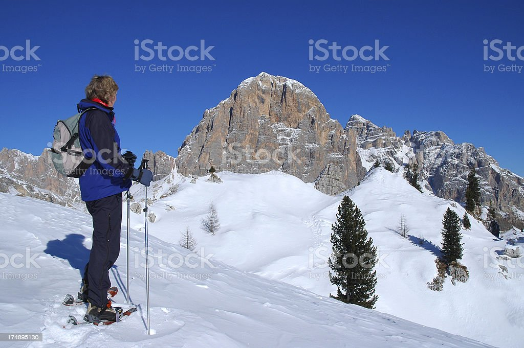 Snowshoeing in the Italian Dolomites stock photo